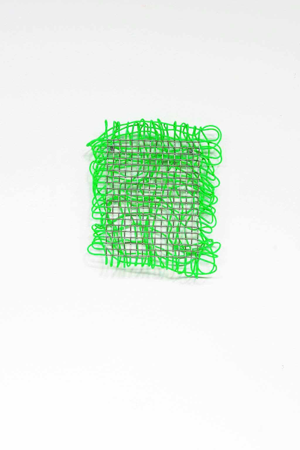 Steel mesh and shrink plastic. 17 x 13 x 4cm