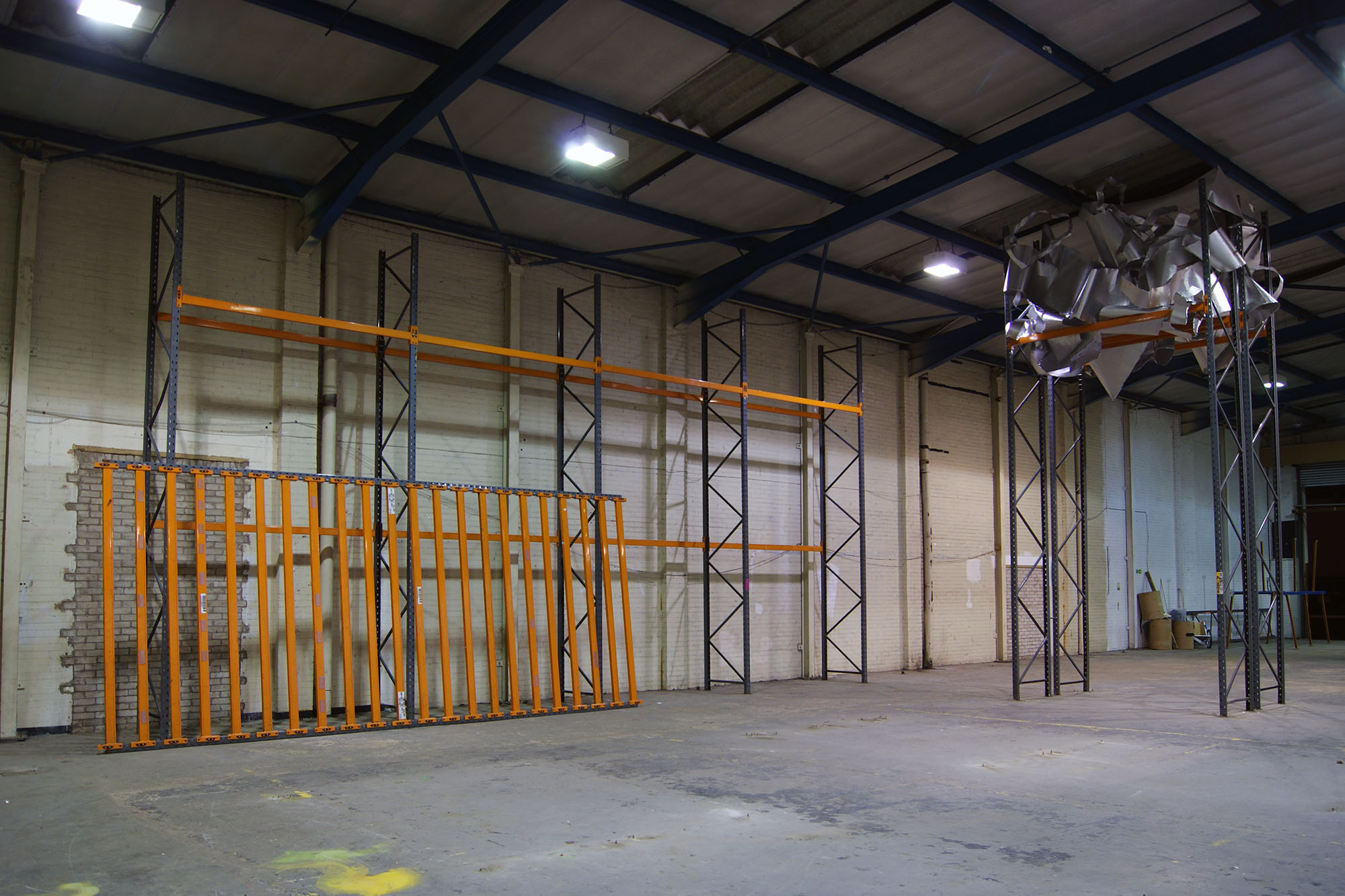 Powder coated steel racking. Site specific installation at Caustic Coastal. Approx 12 x 6 x 2m