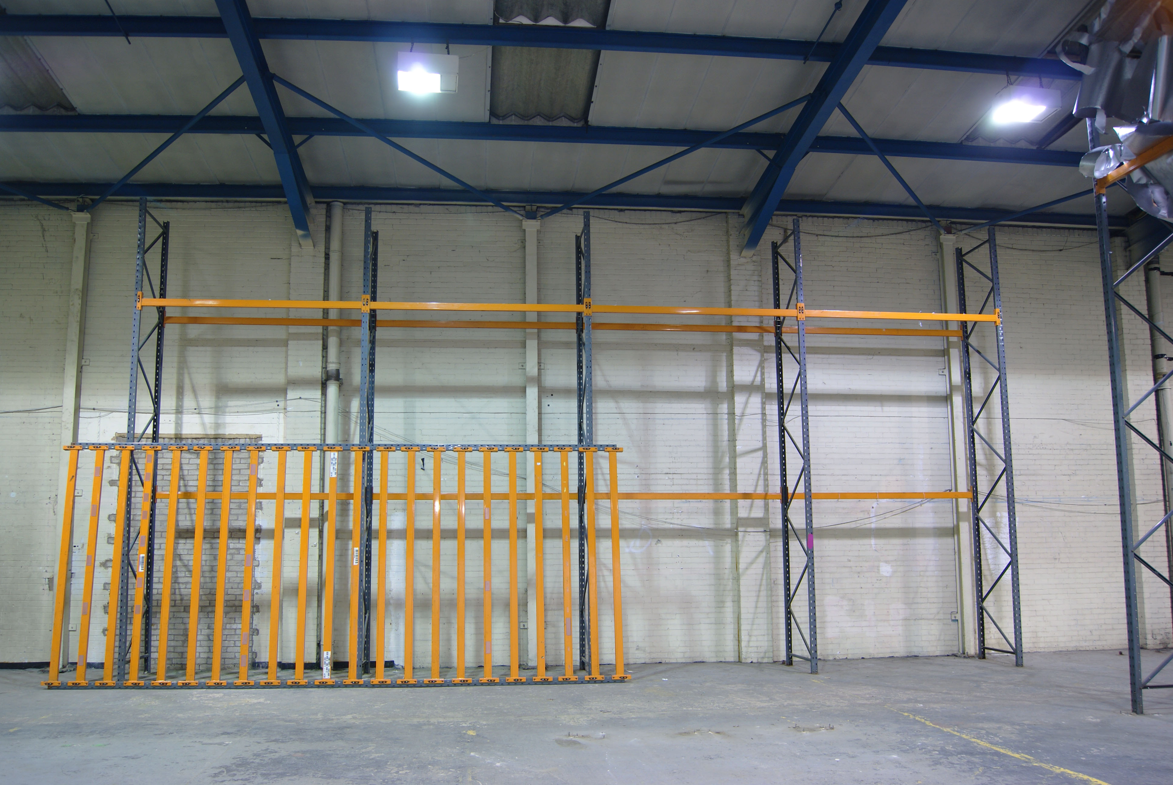 An orange inclination.  Powder coated steel racking.  Site specific installation at Caustic Coastal. Approx 12 x 6 x 2m.