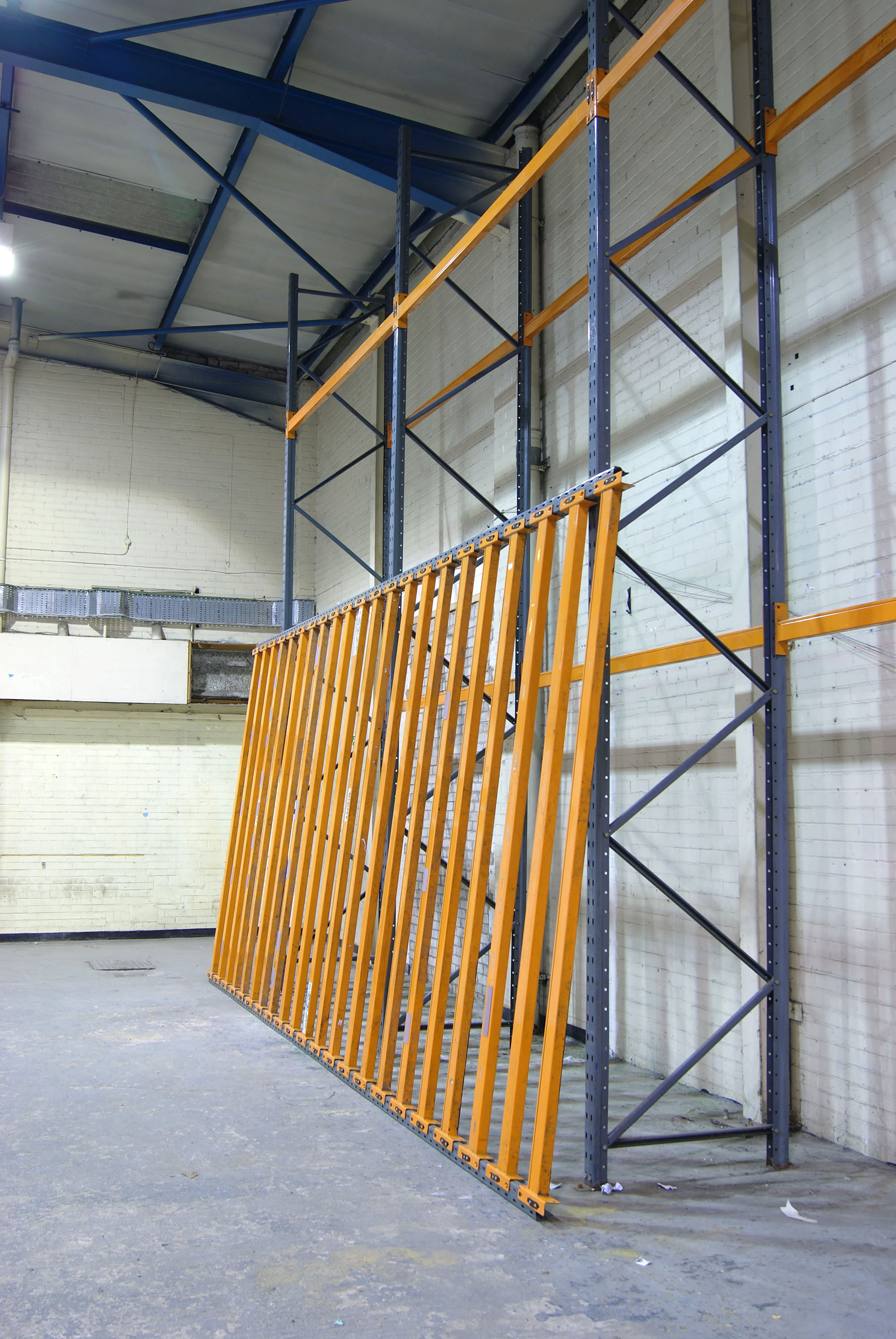 An orange inclination.  Powder coated steel racking.  Site specific installation at Caustic Coastal. Approx 12 x 6 x 2m