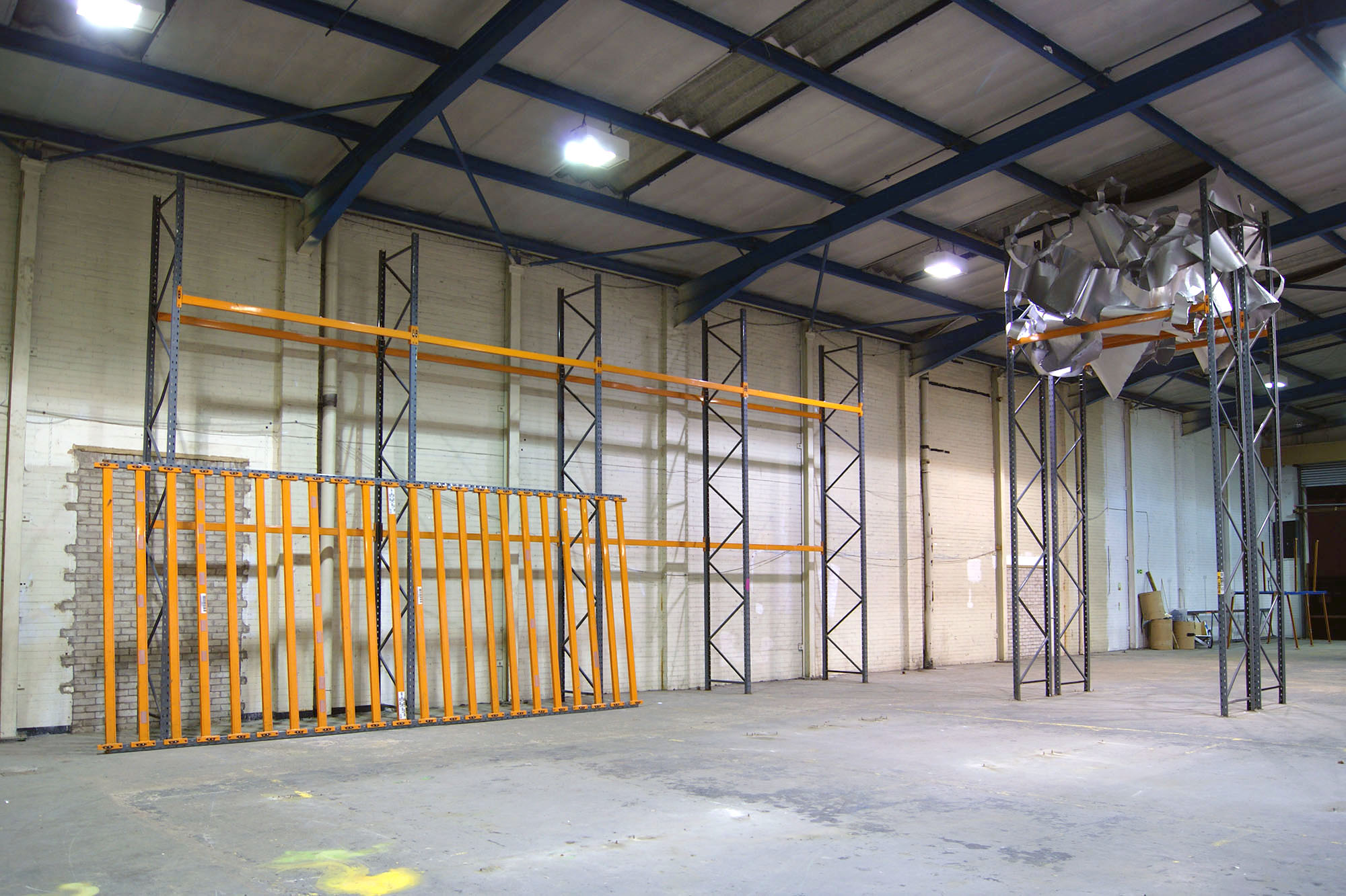 (Left) An orange inclination.  Powder coated steel racking.  Site specific installation at Caustic Coastal. Approx 12 x 6 x 2m. (Right) Critical mass. Steel powder coated racking and aluminium.  Site specific installation at Caustic Coastal. Approx 7m x 4m x 3m. Both  2016