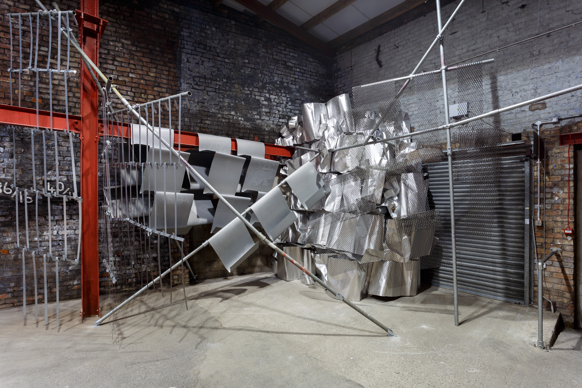 Mild steel and Aluminium. Site responsivse installation at AIR Gallery, Altrincham. 5m x 5m x 7m approx. 2017. Image credits: Jules Lister